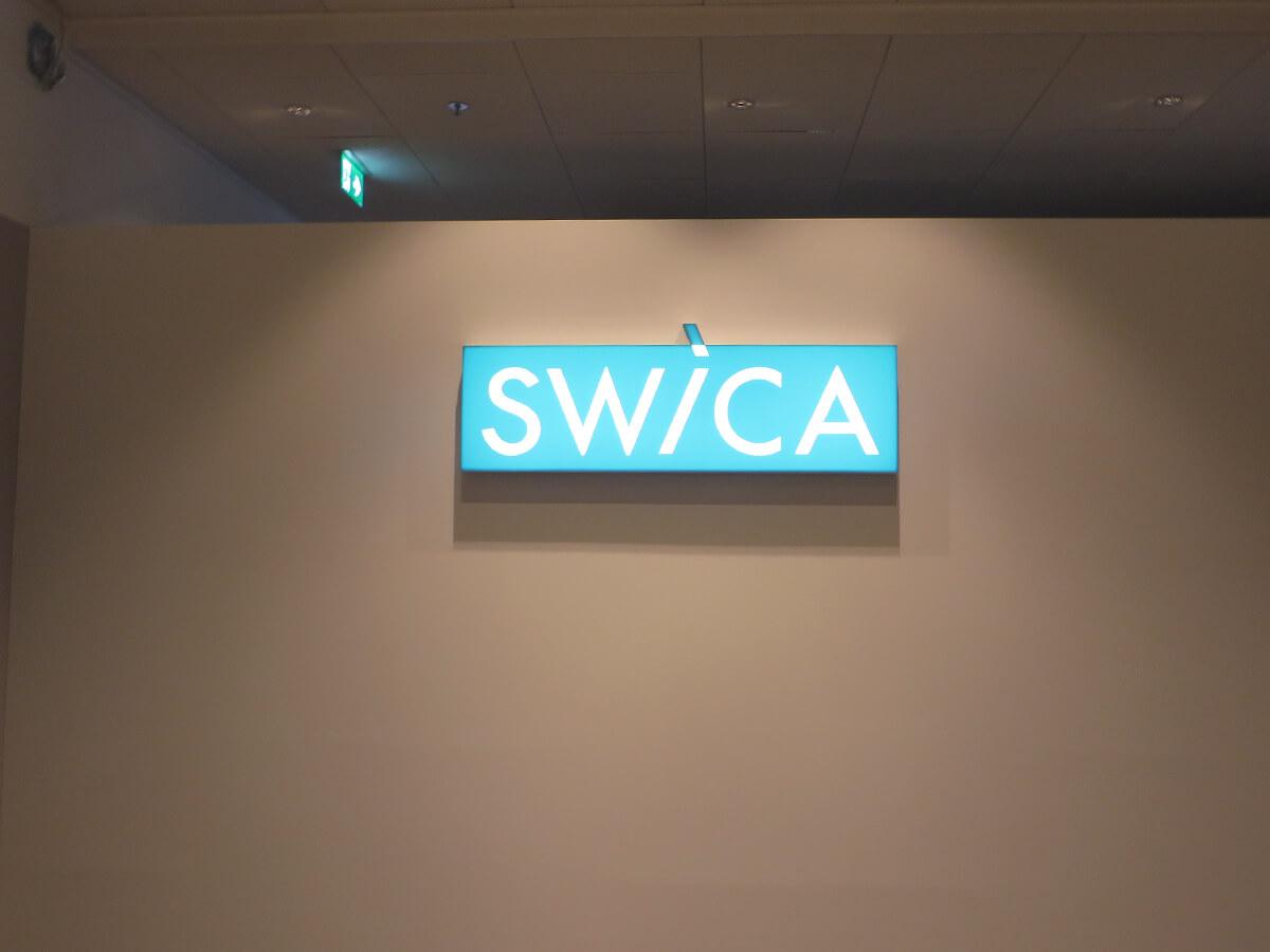 Neoprop Innenbeschriftung Swica Leuchtransparent